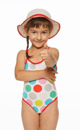 child swimsuit: Smiling girl in swimming wear showing thumb up sign, isolated over white background Stock Photo
