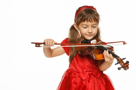 Girl playing the violin over white background photo