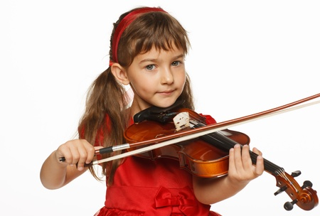 string instrument: Girl playing the violin over white background