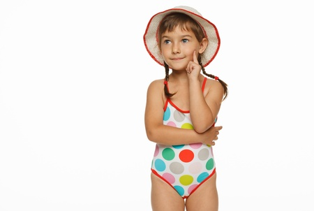 Young beautiful girl standing in swiming wear, isolated over white background  photo