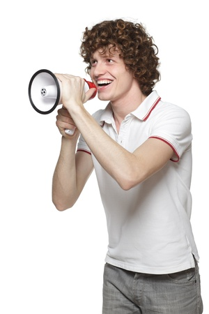 bellowing: Happy man making announcement over a megaphone against white background Stock Photo