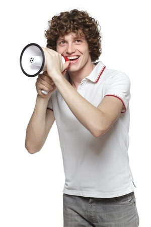 making an announcement: Happy man making announcement over a megaphone, looking upwards against white background