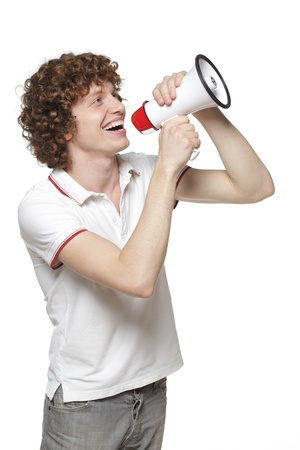 Happy man making announcement over a megaphone against white background Stock Photo - 16716953