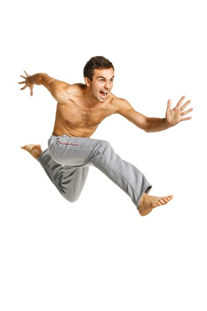 to hasten: Full length of a male flying against white background