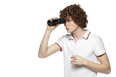 Portrait of a young male looking for new opportunities, over white background Stock Photo - 16796534