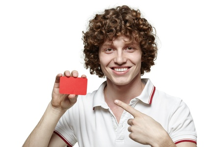Close up of young man pointing to the blank card he is holding, isolated on white background Stock Photo - 16796526