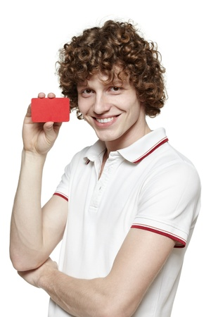 Portrait of the young smiling man holding blank credit card, isolated on gray background Stock Photo - 16796533