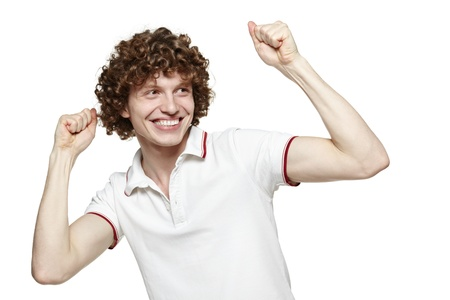 hooray: Portrait of a very happy young man with his arms raised, over white background