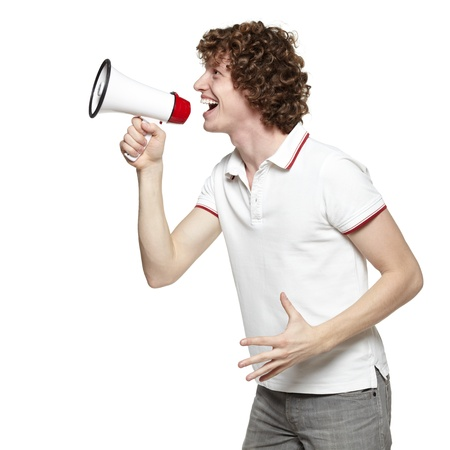 Side view of young man yelling into the megaphone, over white background Stock Photo - 16796528