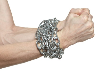 Man hands fettered with chain, job slave symbol, isolated on white background photo