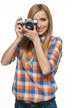 Smiling casual female with camera on white background photo