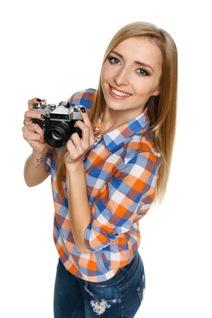 High angle view of smiling casual female with camera on white background Stock Photo - 17039869