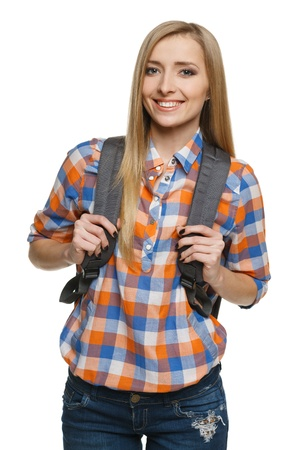 Young female with backpack, over white background  College university student  Stock Photo - 17039872