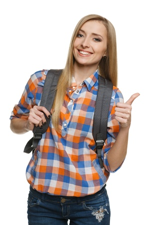 Young female with backpack showing thumb up sign, over white background Stock Photo - 17039868