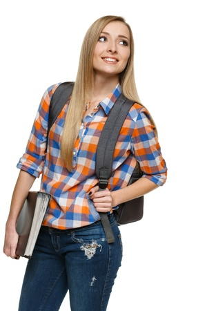 Smiling college university student woman standing with backpack holding folder looking to the side, isolated on white background Stock Photo - 17039867