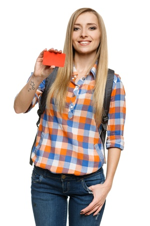 Smiling female student holding empty credit card, over white background photo