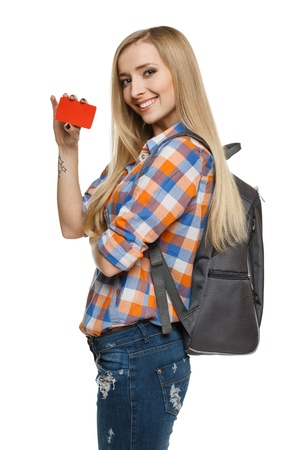Smiling female student holding empty credit card, over white background Stock Photo - 17039870