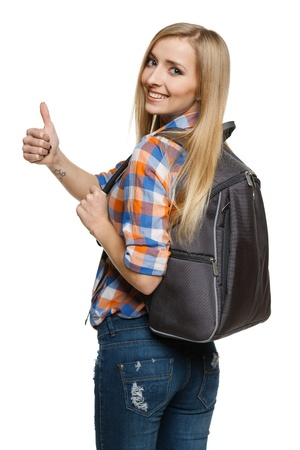 back packs: Young female with backpack showing thumb up sign, over white background Stock Photo