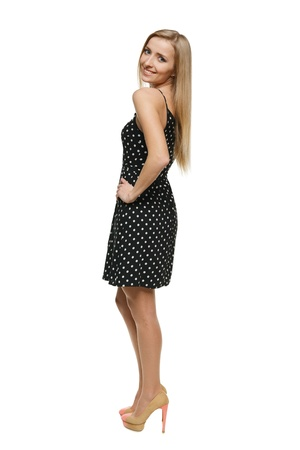 Young playful woman in dress standing in full length, over white background Stock Photo - 17039908