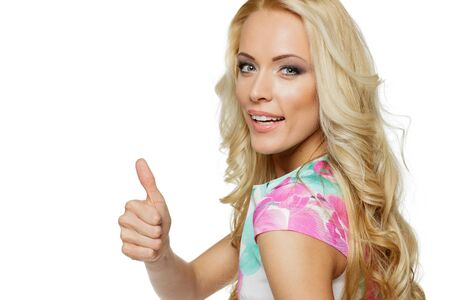 Closeup of happy woman showing thumbs up gesture on white background Stock Photo - 17055097