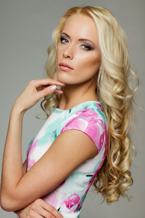 Woman with beauty long blond hair posing at studio, over gray background Stock Photo - 17055092