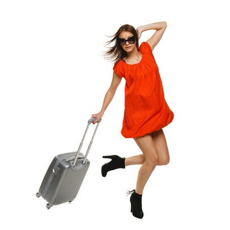 Bright picture of excited female in full length hurrying with suitcase photo