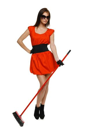 Cleaning company concept  Full length of woman standing with broom, isolated on white background Stock Photo - 17055142