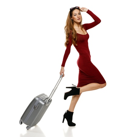 Fashionable woman running with suitcase, over white background Stock Photo