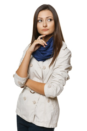Discontent pensive woman looking to the side, over white background photo