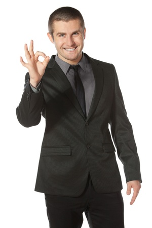 Happy businessman showing OK sign, isolated on white background photo