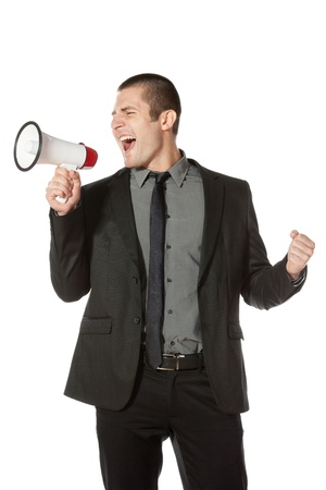 man screaming: Portrait of a young business man yelling into a megaphone  Stock Photo