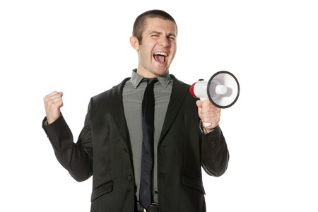 Portrait of a young business man yelling into a megaphone Stock Photo - 17157613