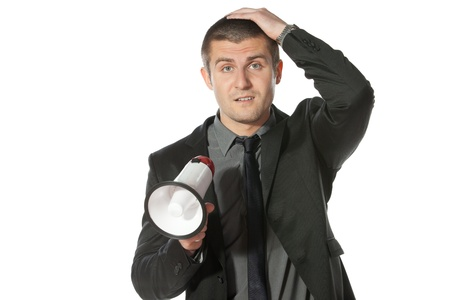 bellowing: Portrait of a young business man holding megaphone  Stock Photo