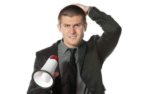 Portrait of angry young business man holding megaphone Stock Photo - 17157615