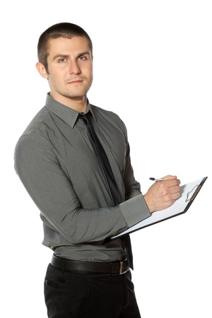 competent: Business man making notes  on a clipboard