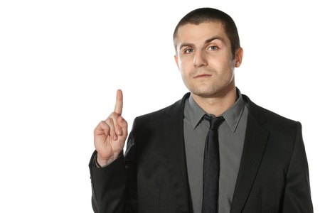 Close up of young business man pointing up at copy space over white background photo