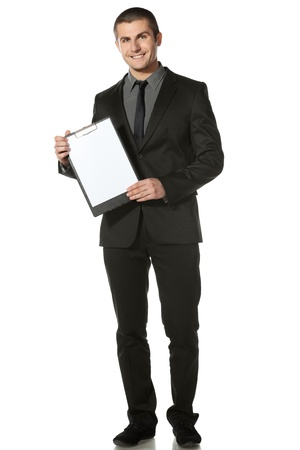 Full length of businessman holding blank board, isolated on white background
