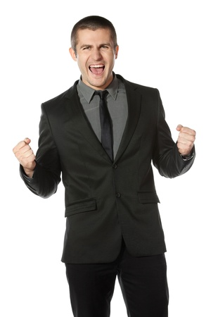 Happy young business man celebrating success over white background Stock Photo