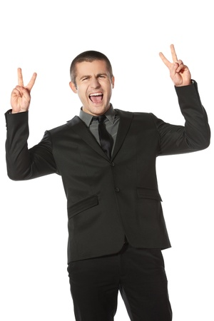 Happy young business man celebrating success shouting and showing victory signs over white background photo