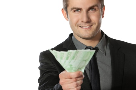 Young business man offering pack of Euro money over white background photo