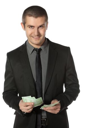 batch of euro: Young business man counting Euro money over white background Stock Photo