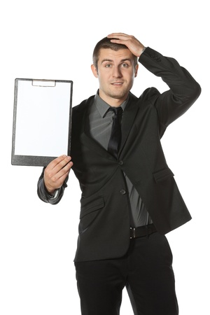 Young anxious businessman holding his head with hands. Worried businessman holding blank board, isolated on white background photo