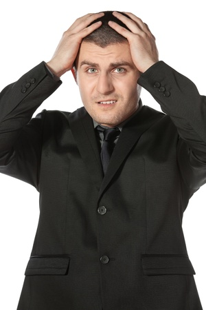 Frustrate young business man holding his head against white background Stock Photo - 17281696