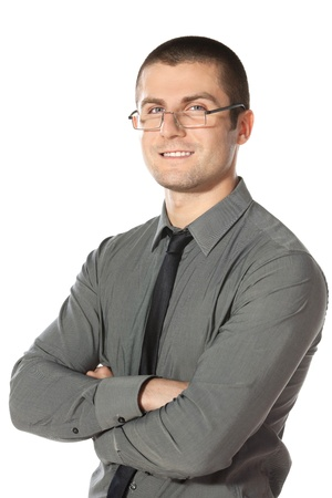 folded hands: Portrait of young businessman in eyeglasses with hands folded isolated on white background