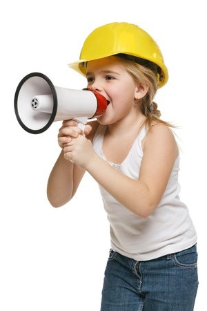 loudspeaker: Pretty little girl builder in yellow helmet screaming into the loudspeaker, over white background