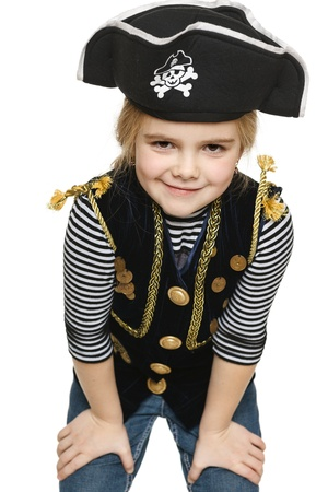 inquiring: Grinning little girl wearing pirate costume, over white background