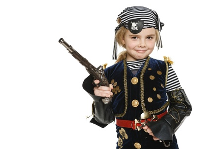 Little girl wearing pirate costume holding a gun, over white background photo
