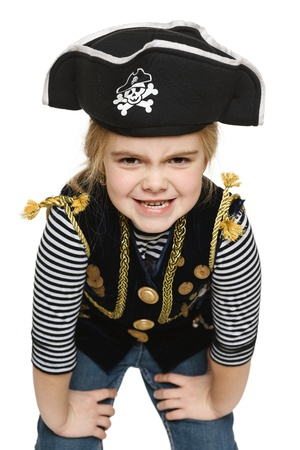 children celebration: Grinning little girl wearing pirate costume, over white background