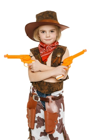 Little girl with wearing cowboy costume holding guns, over white backgrounf