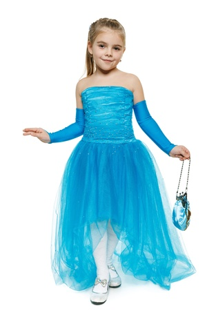 curtsy: 6 years old girl wearing blue ball dress in full length making curtsy, over white background